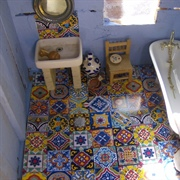 The simple bathroom had had brightly-coloured local tiles.