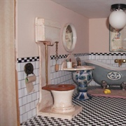 The bathroom in Cosy Cott. Another soap dish bath plus egg cup sink ...