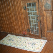 The panelling almost made the grandfather clock invisible, so when it ...