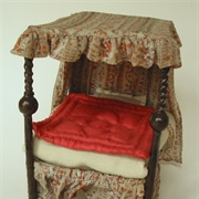 Four poster bed with original drapes and bed clothes.