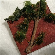 Using railway model scenery pieces and a twig from a rosemary bush