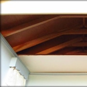 The partial ceiling in the bedroom