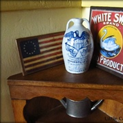 Detail of White Swan Food Products tray, and patriotic stoneware jug.