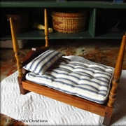 I hand stitched a blue and white ticking mattress and pillow for the ...