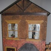 Here is Jill's tiny replica in front of my Alice villa