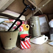 Bedpan, toys, ration book and stirrup pump