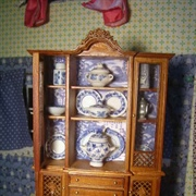 Blue and white china collection put in half-price damaged cabinet.