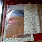 sticky back fabric with foil inner to make drapes...