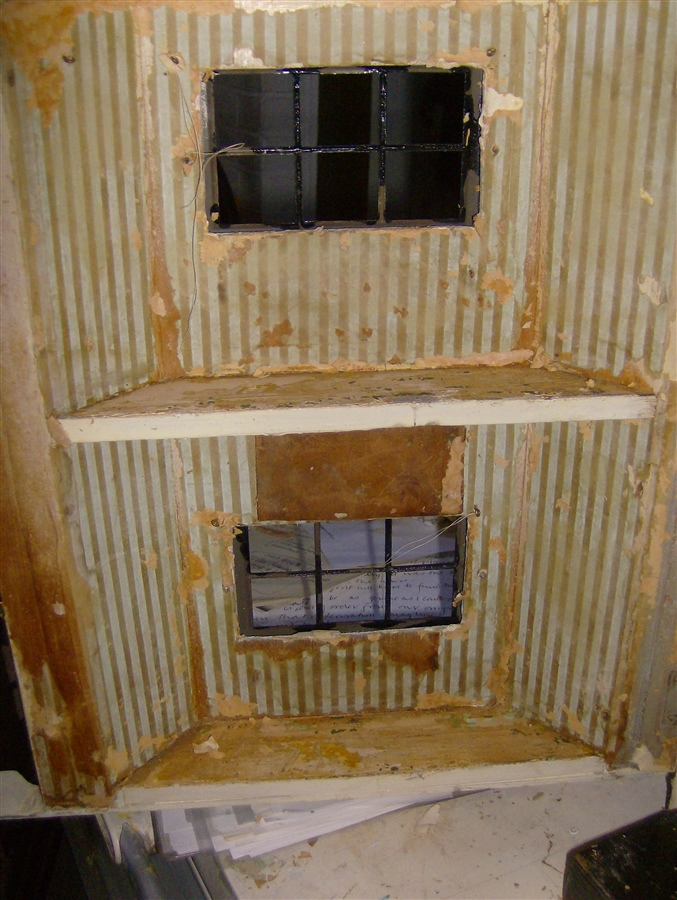 Original paper, The wood block above lower window is to hold broken wood together.