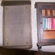 Wire mesh base bed and bookcase with Pit- a Pat Library inside.