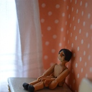 Tiny jointed wooden doll