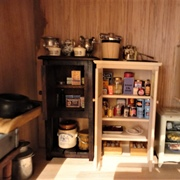 Ketterley's temporary scullery: storage cupboards and refrigerator