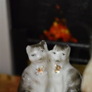 These china cats are badly  chipped, but I love them!