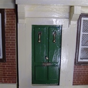 The shiny green door looked very formidable with it's two knockers ...