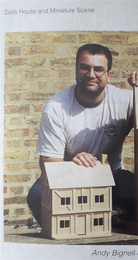 Andy with his little Tudor House. (Photo taken from Dolls House & Miniature Scene magazine).