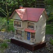 I love the look of dolls' houses out of doors