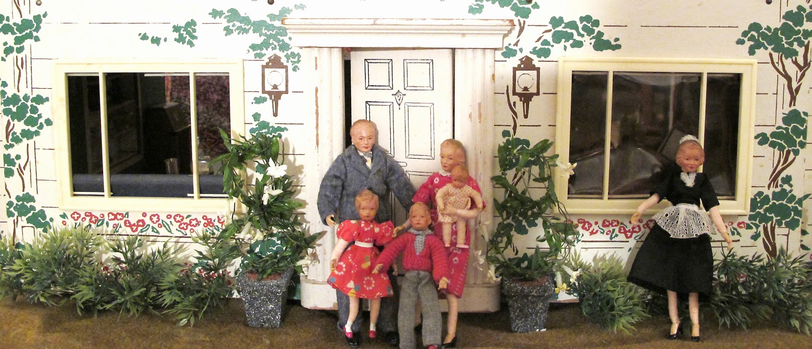 The family poses outside the front door