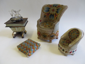 Embroidered easy chairs and footstool, with the needlecase worktable