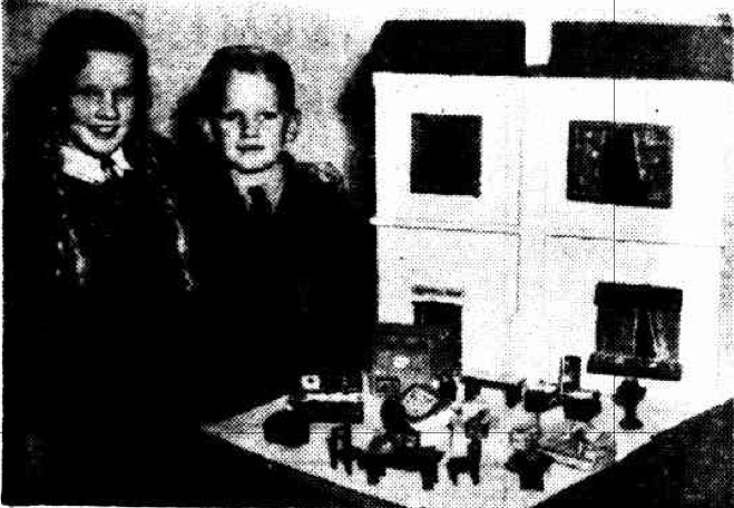Photo from 1944 newspaper of two children with dolls house they made