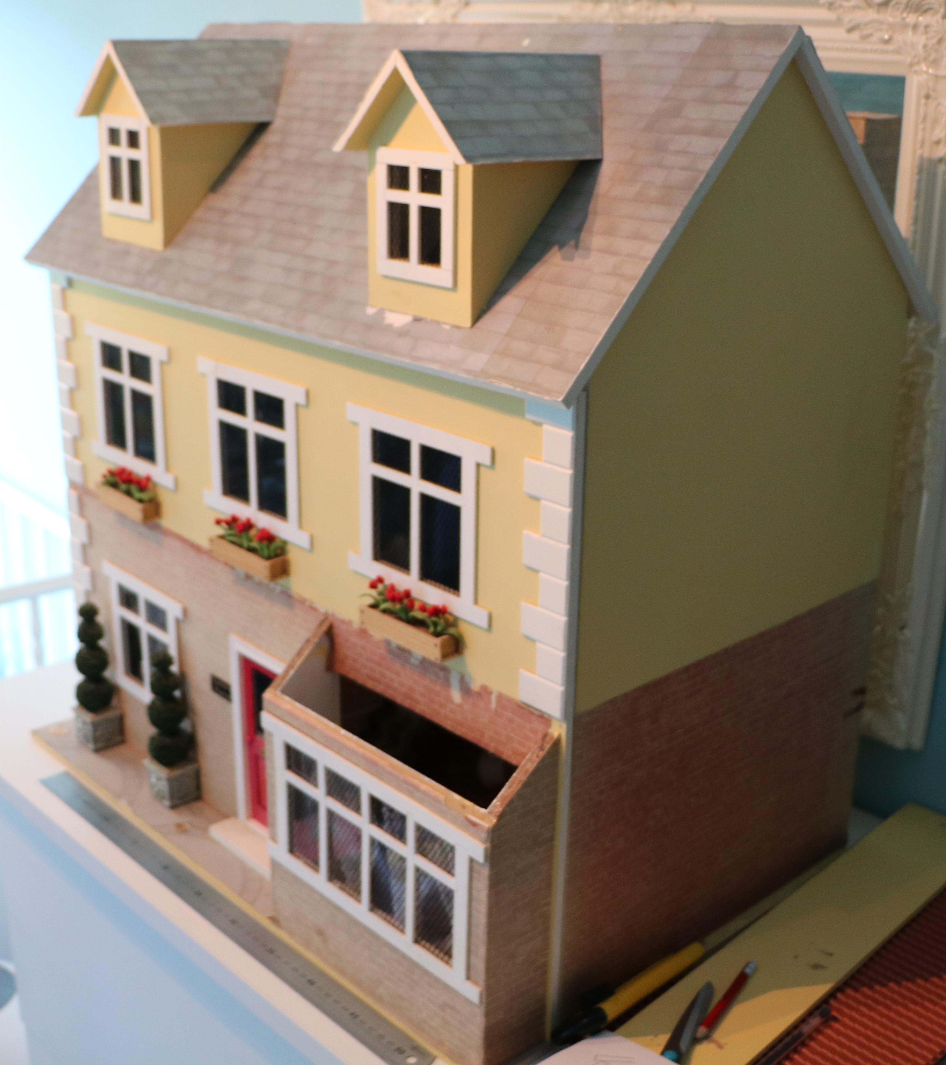 2 storey dolls house with square bay window and 2 dormer windows