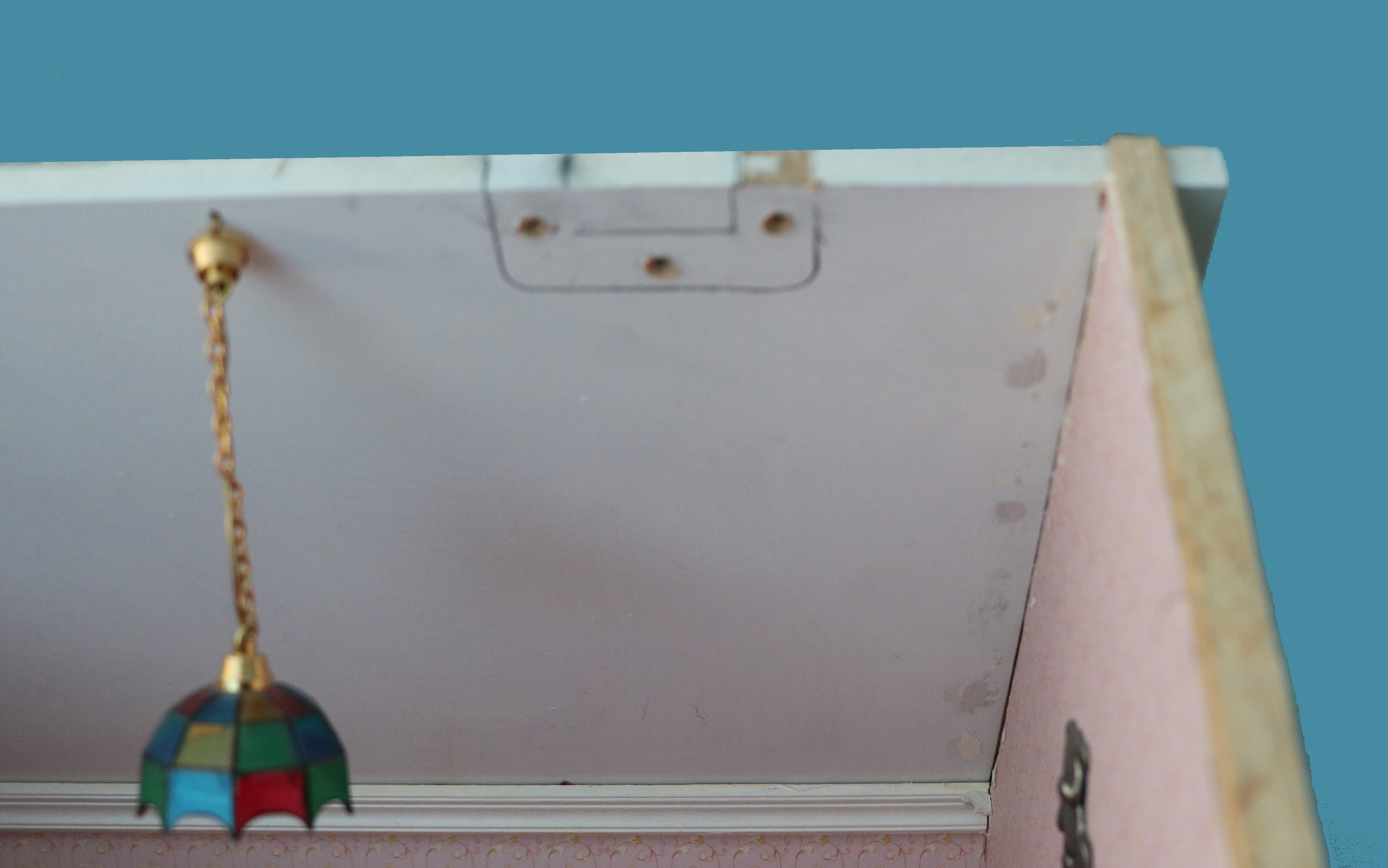 Inner back pitched roof of dolls house showing how hinges were placed