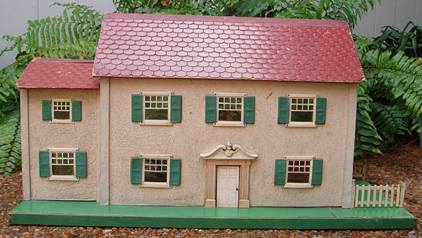 six room Schoenhut dollhouse produced in 1934, main wing similar to house above plus added shorter left wing