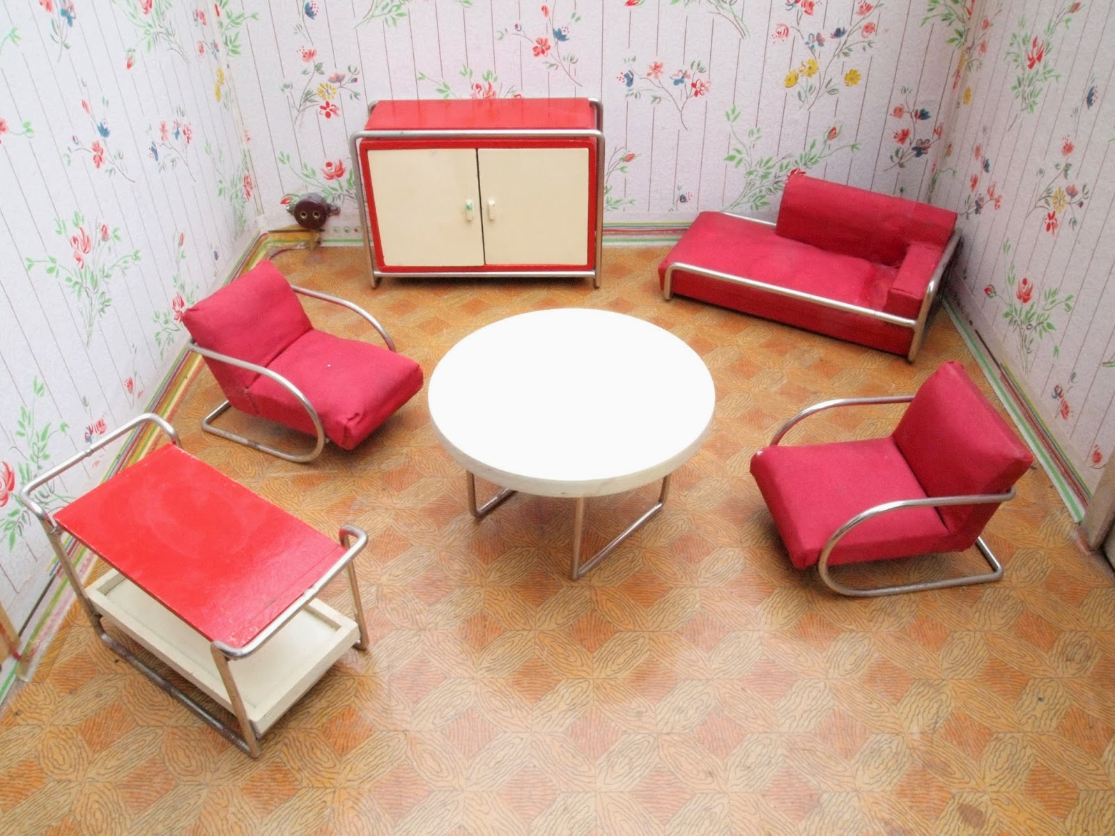 Wood and tubular steel living room set with red upholstery