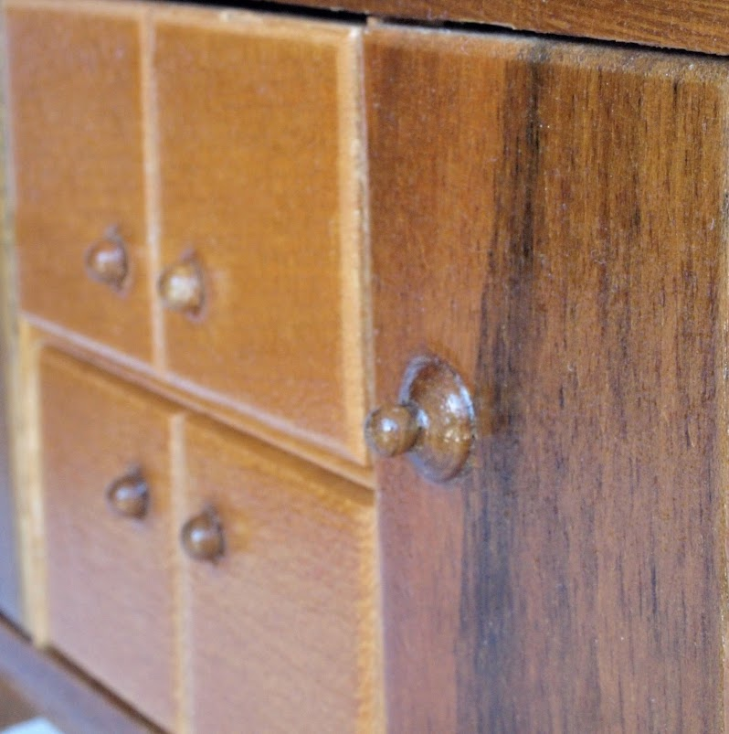 Detail of cabinet with two kinds of knobs