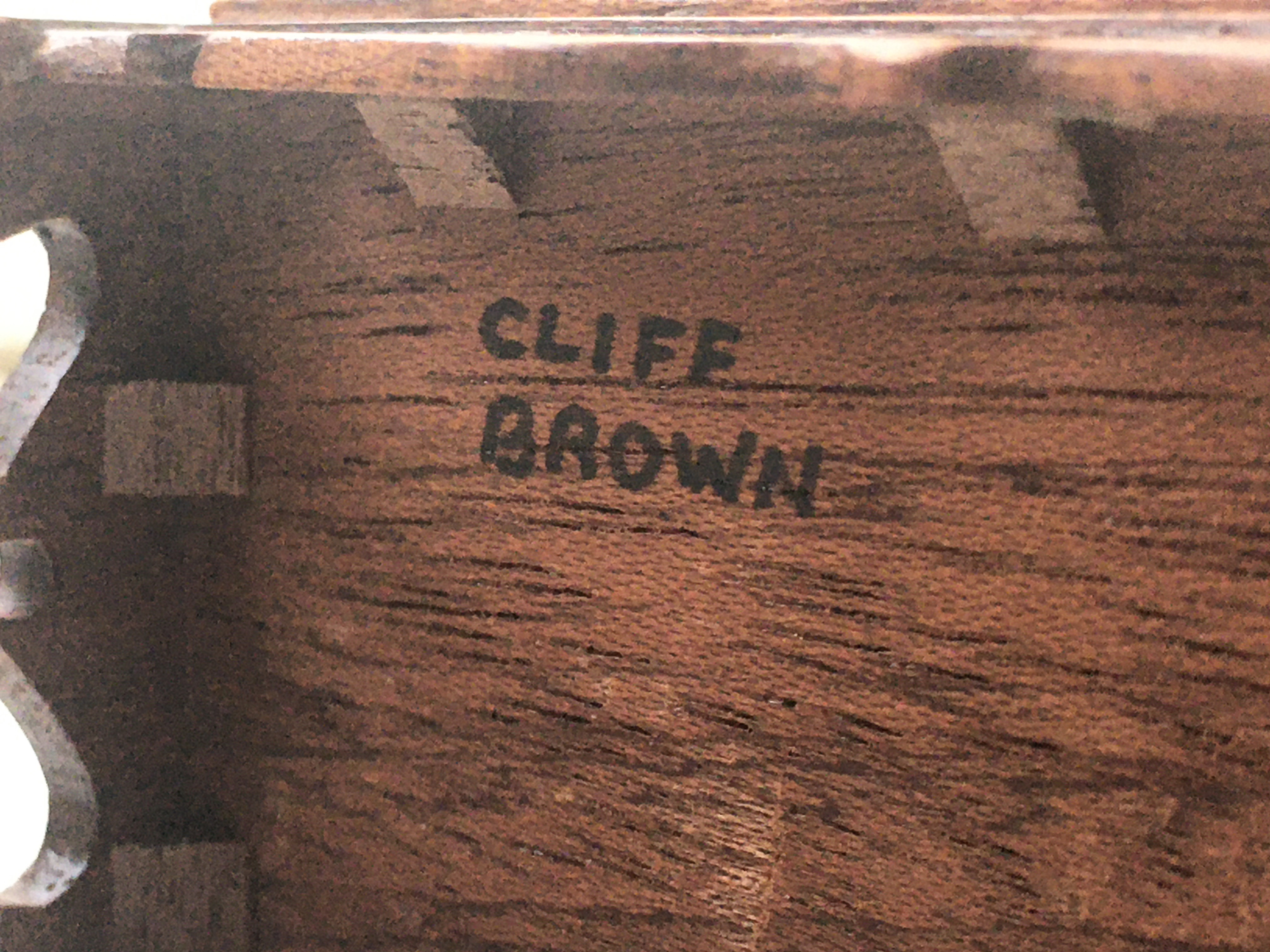 A piece of furniture signed 'Cliff Brown' on the base in black ink and in capitals.