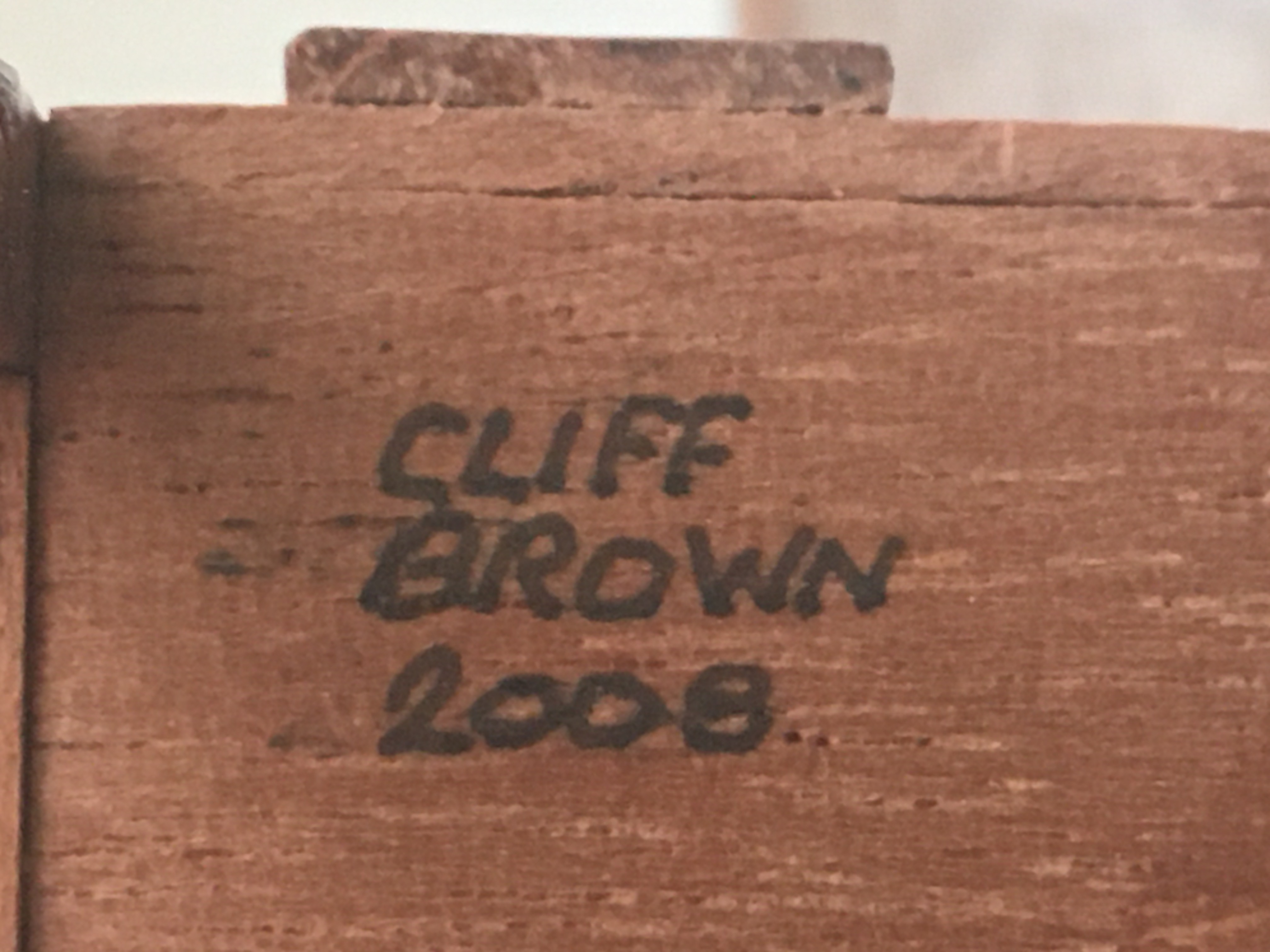A piece of furniture signed and dated 'Cliff Brown 2008' on the base in black ink and in capitals.